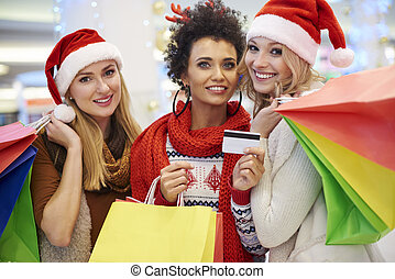 Women paying with credit card for shopping