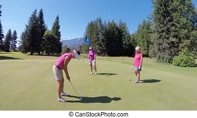 Women playing golf in golf course 4k - Women playing golf in...