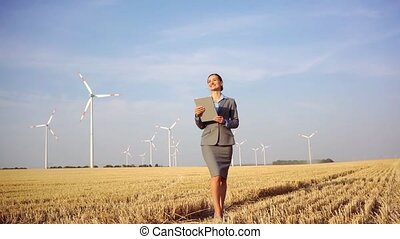 Women putting money into an ethical Investment of wind turbines