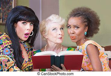 Diverse beautiful mature women reading a romance novel
