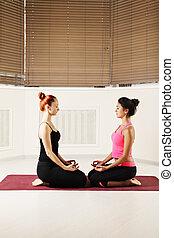 Women relaxing in yoga class