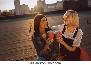 women relaxing on roooftop