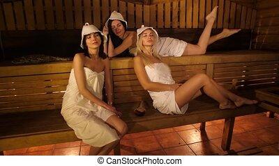 Women resting in sauna - Three girlfriends resting in sauna