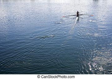 Women Rowing In A Lake