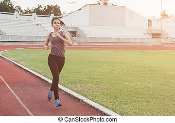 Women runners sprinting outdoors. healthy lifestyle and sport concepts.