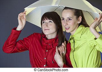 women running from rain