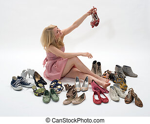 women shoes - happy young blond woman sitting on the floor...