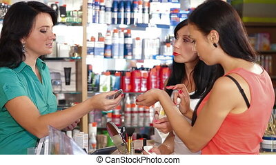 Women Shopping for Cosmetics