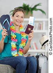 women showing her flipflops and passport