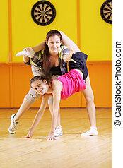 Women shows acrobatic composition