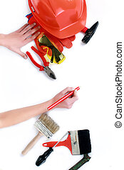 Women shows construction tools, isolated on white background