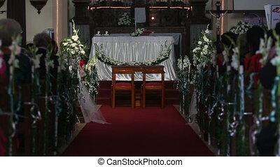 Women sit on wedding ceremony in church - PARVORIM,...
