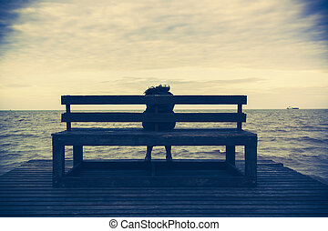 Women sits on a wooden chair