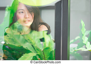 Women sitting by the window at coffee shop for relax