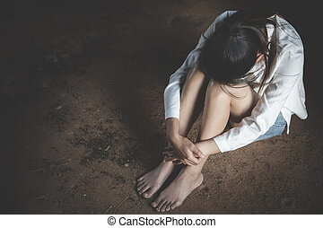 Women sitting on the floor crying with depression, Depressed woman, family problems, Stress, kitchen, abuse, Domestic violence, The concept of depression and suicide.