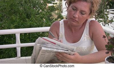 Women solving crossword puzzle