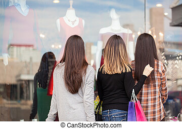 Women standing in front of a clothing store