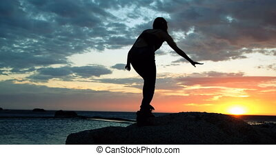 Women standing on rock at beach during dusk 4k - Silhouette...