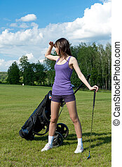 Women stay on green golf field