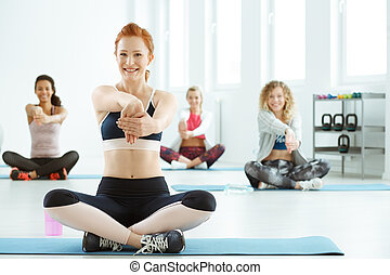 Women stretching arms