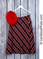 Women striped skirt hanging on hanger.