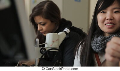 Women students Indian and Asian attend a practical training...