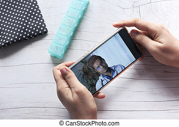 women taking online consultation with doctor on smart phone