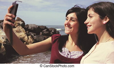 Women taking selfie with cell phone
