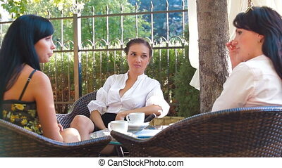 Women Talking at Outdoor Cafe