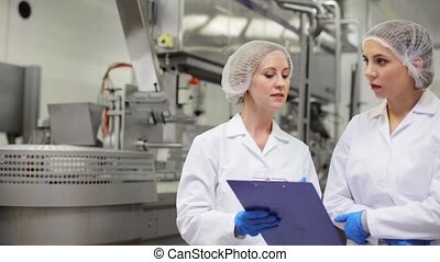 women technologists at ice cream factory - manufacture,...