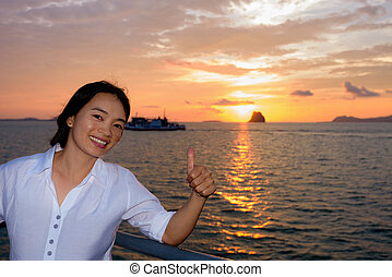 Women tourist cruising at sunset