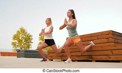 women training and doing single leg squats - fitness, sport ...