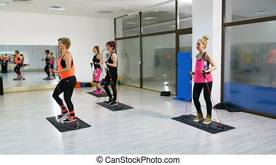 Women training and doing working out at the gym