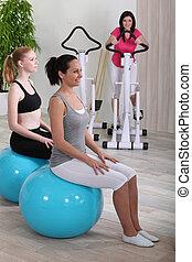 Women training in fitness club