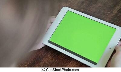 women using digital tablet computer with green screen