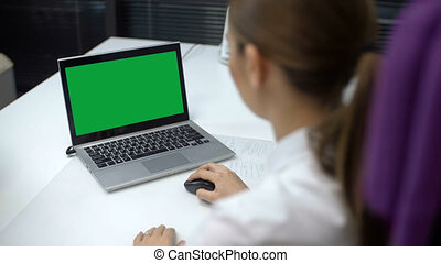 Women Using Laptop with Green Screen