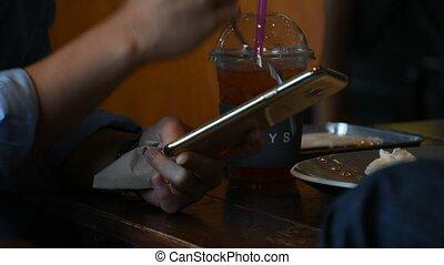 Women using smartphone in coffee shop - Chanthaburi,...