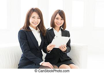 women using tablet computer