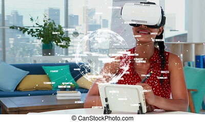 Side view of a young women discovering virtual reality glasses in a house