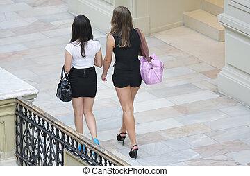Women walking indoors