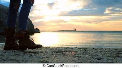 Women walking on beach 4k - Low section of women walking on...