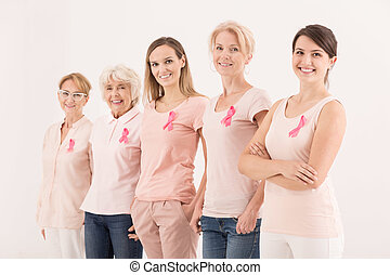 Women wearing pink color, united against breast cancer