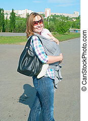 women with a little child in sling