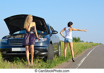 Women with a roadside breakdown telephoning for assistance...