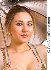 women with a silver umbrella
