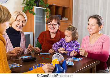 women with child having fun with game