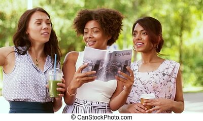 women with city guide and drinks on street - tourism,...