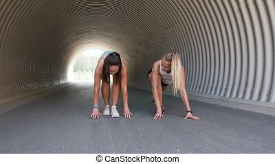 women with fitness trackers stretching outdoors - fitness, ...
