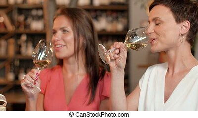 women with gift drinking wine at bar or restaurant - people,...