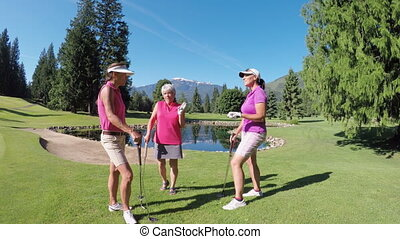 Women with golf club talking in the golf course 4k - Three...